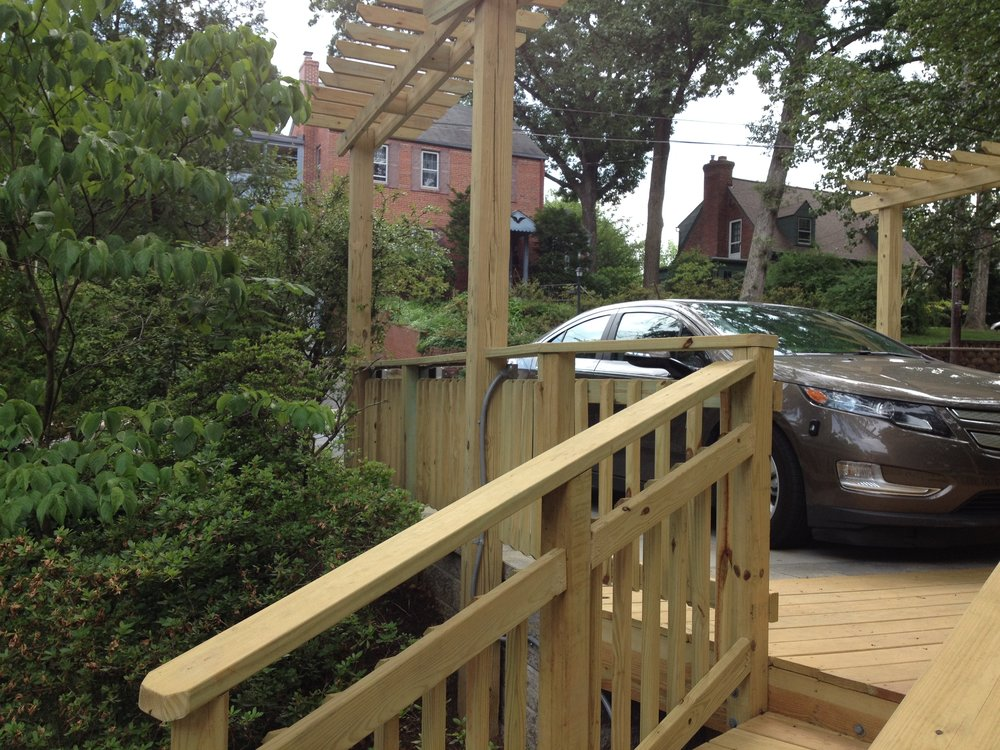 Arbor, parking area and access deck for auto-charging area.