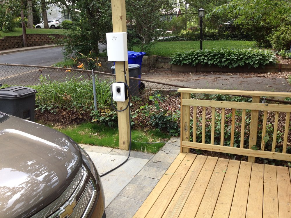 Auto-charging system mounted on arbor post.