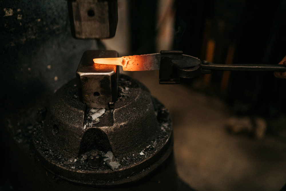 The tang is forged under the air hammer.