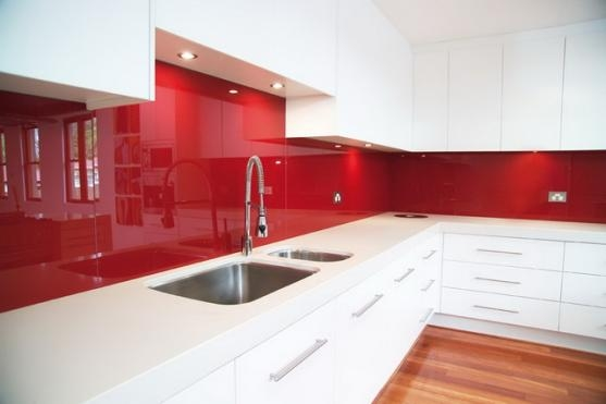The glass splashback drove tiles into near extinction in the kitchen. Image Source - homeimprovementpages.com.au