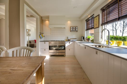 A modern, clean, functional kitchen. But it wont be to everyone's liking. Should you buy the house if you don't like the fairly new kitchen? Image source - pexels.com
