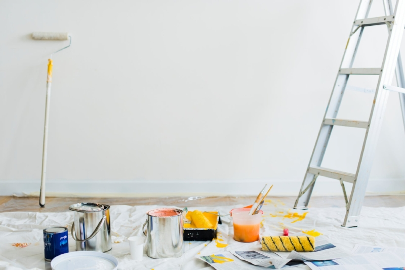 Painting is a breeze if the rooms are empty. But should you paint if its already freshly painted? Image Source - Pexels.com
