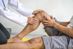 stock-photo-physiotherapist-giving-exercise-in-clinic-634433477.jpg