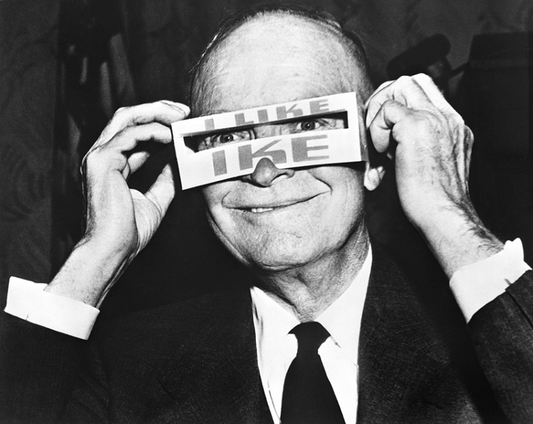 "President Dwight Eisenhower wearing ""I Like Ike"" glasses"