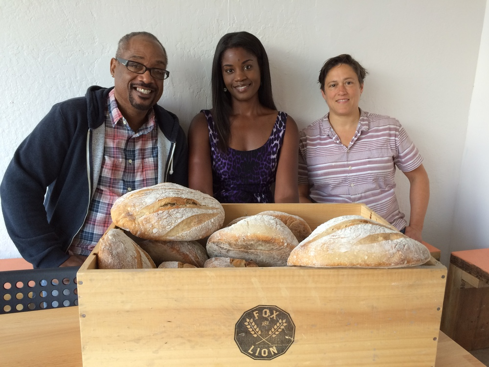 Bayview residents Julius Crane and Tyra Fennell with Xan DeVoss, owner of the new Fox & Lion bakery on Third Street.