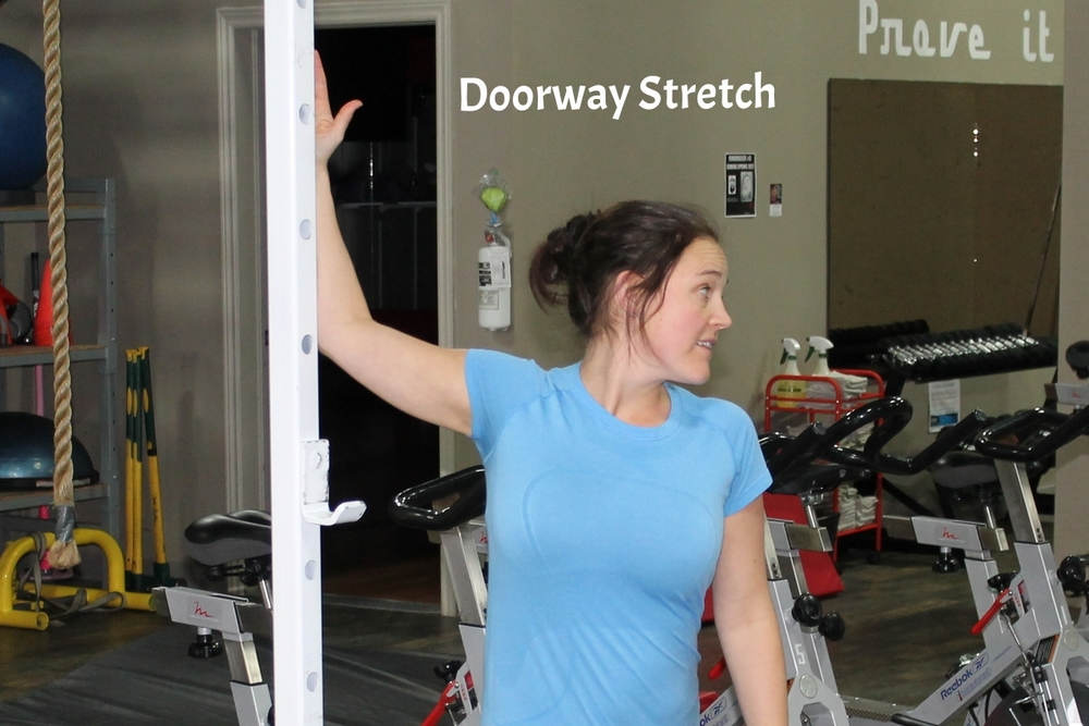 Stand in a doorway and put one arm out at 90 degrees. Press your palm, forearm and elbow against the doorway and twist your chest away from the arm, turning your head away as well. Hold for 15 to 30 seconds then repeat on opposite side.