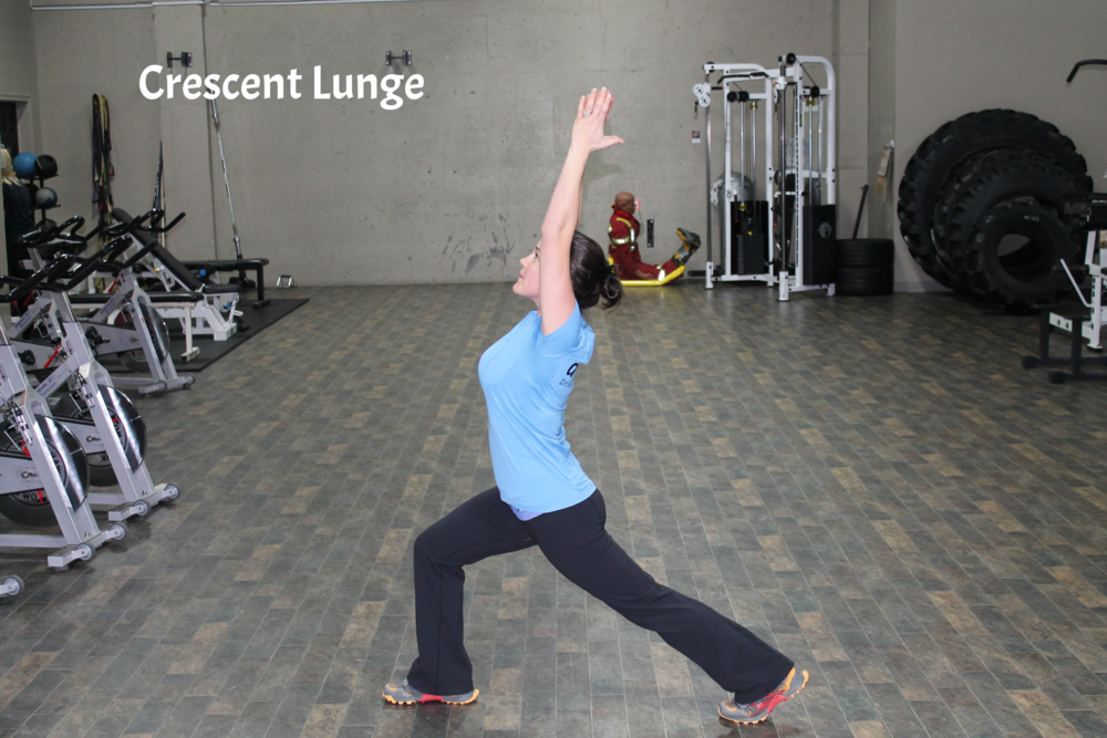 Step one foot back, lower into a slight lung with the front leg knee directly over the front ankle. Keep the back leg straight and reach the arms up towards the ceiling, coming into a slight back bend. The stretch should be felt in the front of the hip of the back leg. Hold for 30 to 60 seconds and repeat on other side.