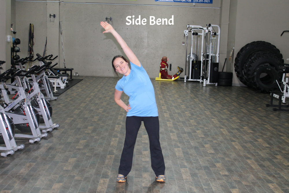 Stand with feet hip to shoulder width apart. Place one hand on the hip and reach the opposite hand over the head, bending slightly to the side creating space between the ribs and the hip bone. Hold for 30 to 60 seconds then repeat on opposite side.