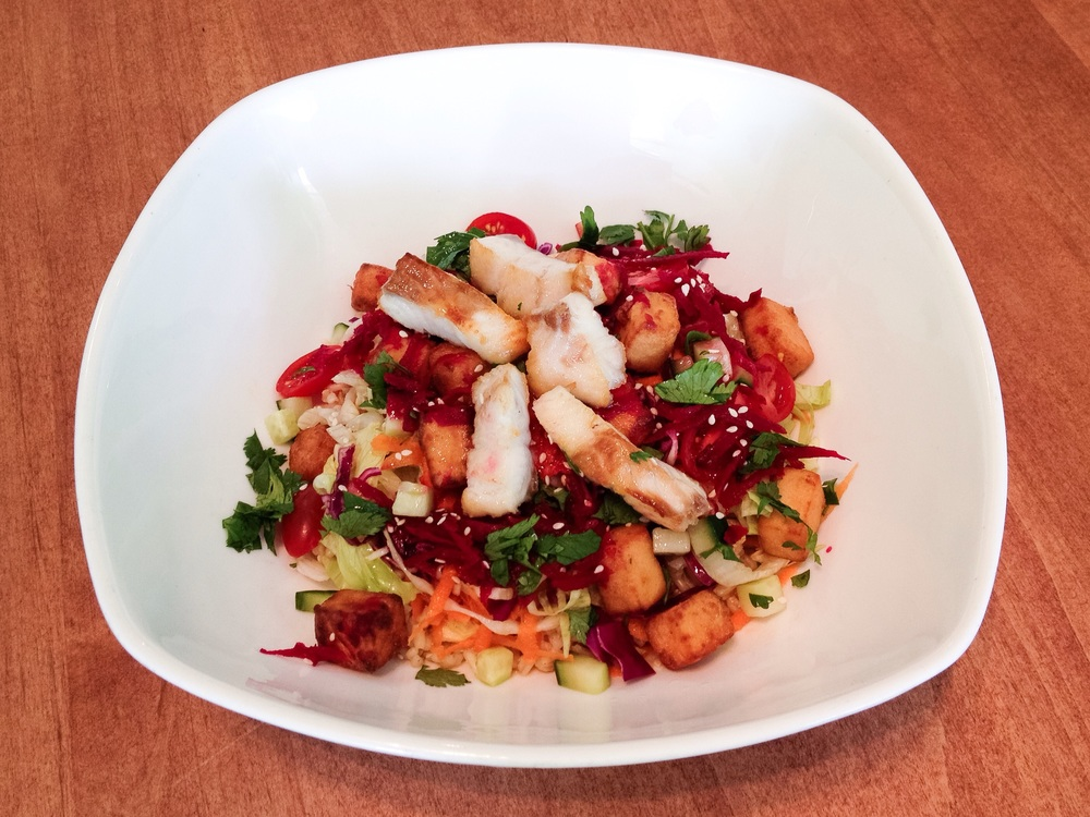 Japanese-inspired rice bowl: Brown rice, fresh local pickerel, cabbage slaw, marinated fried tofu, carrot, cucumber, tomato, pickled beets, scallions, cilantro, sesame seeds and Japanese vinaigrette.