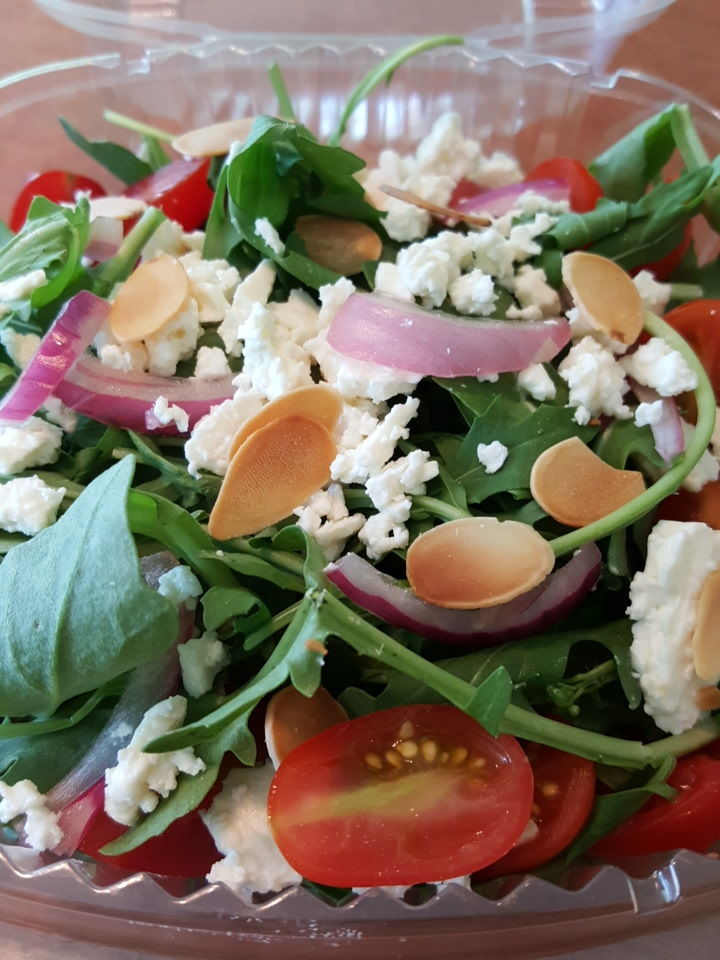 Our Feature Salad this week: Arugula, cherry tomatoes, Feta,  almonds, red onion, herb vinaigrette.