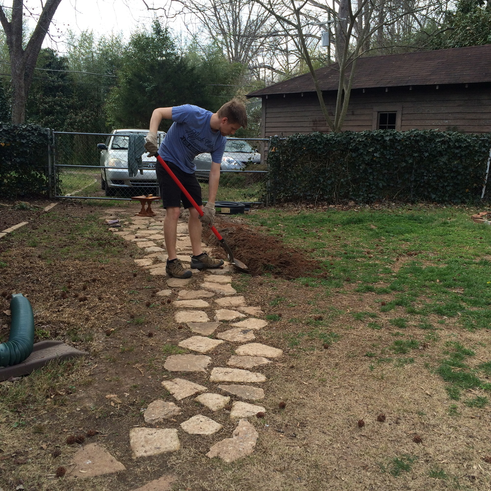 My hard- working husband working on our path out to the shed... which is no longer.