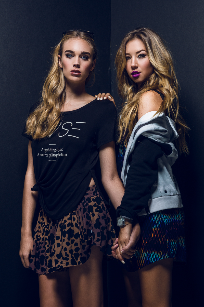 Two fashion models holding hands