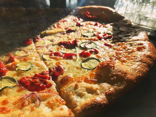 That taste of #spring in the air has us all giddy #dailyspecial #sliceoftheday #pickledpeppers #zucchini