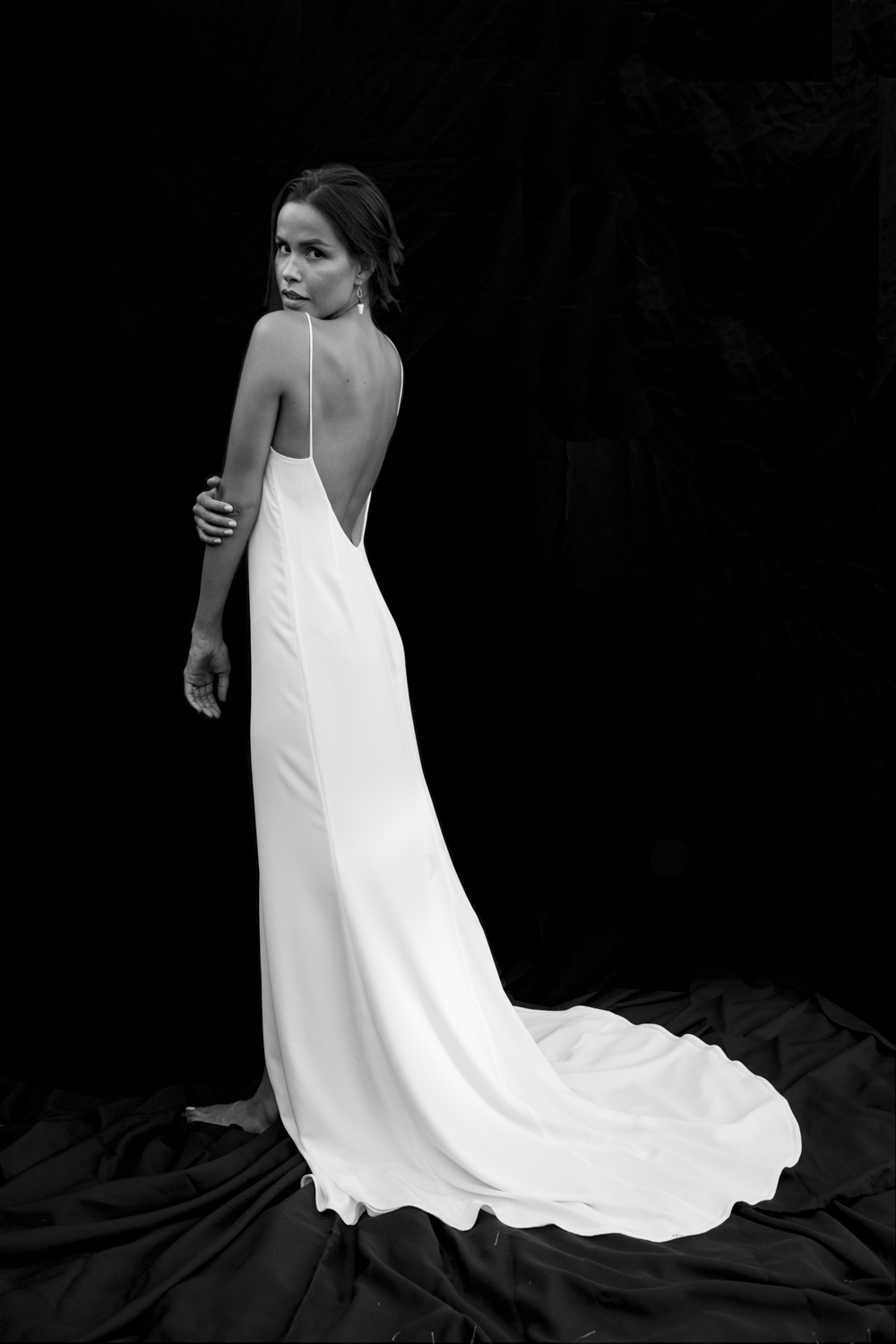 MARIA - Low back crepe slip-gown with an easy fit and buttery feel. Timeless and stunning, whether down the aisle or on the beach.
