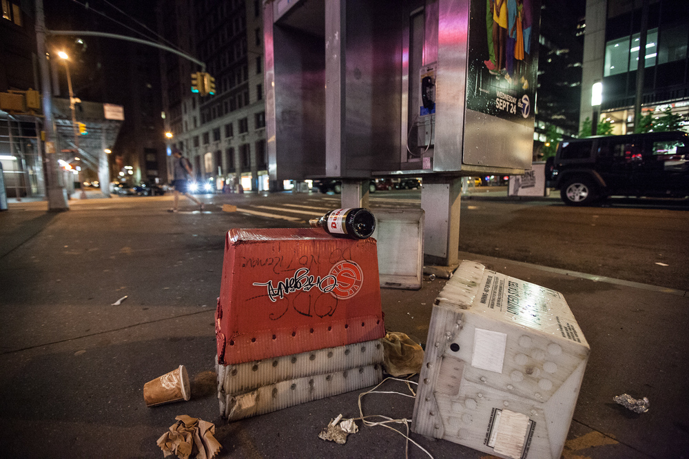 Empty champagne bottle in the Financial District NYC 5:30am