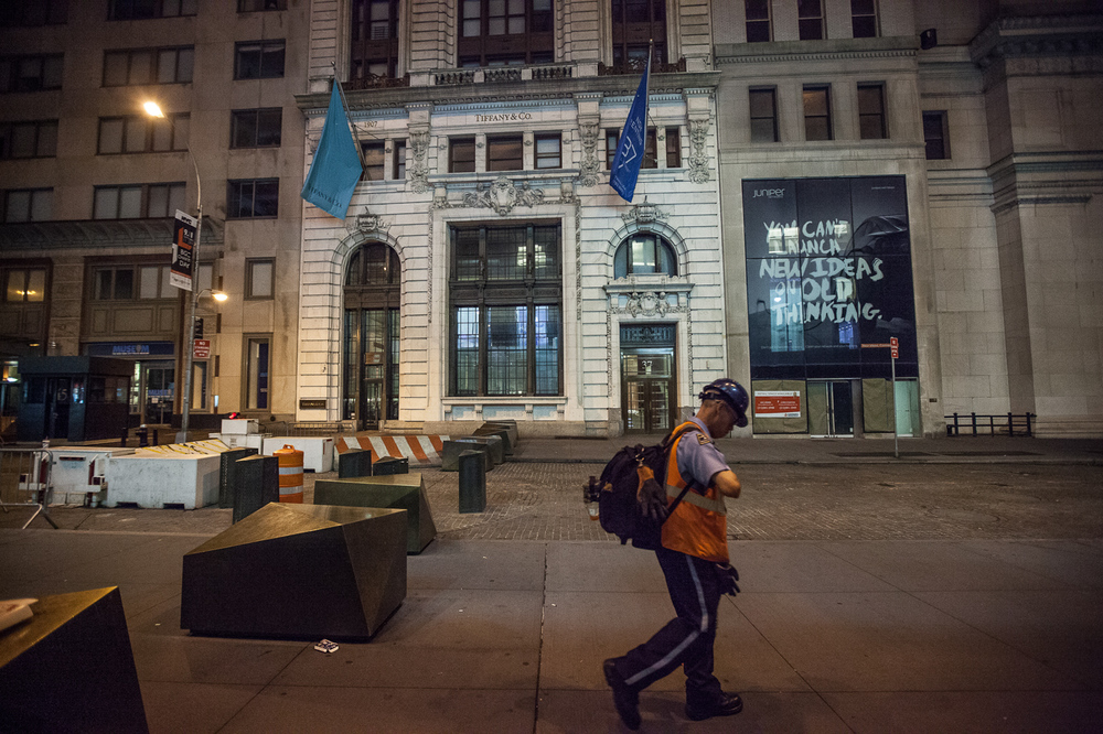 City worker near New York's Wall Street arriving to begin his day 5:30am