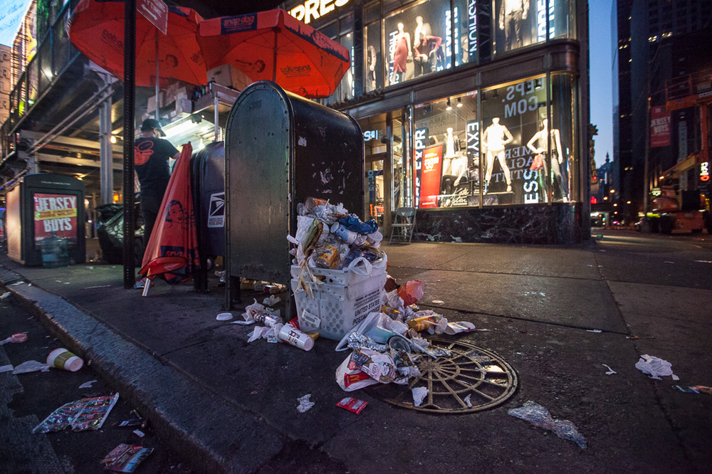 Trash piles in Time Square, New York City 6 am.