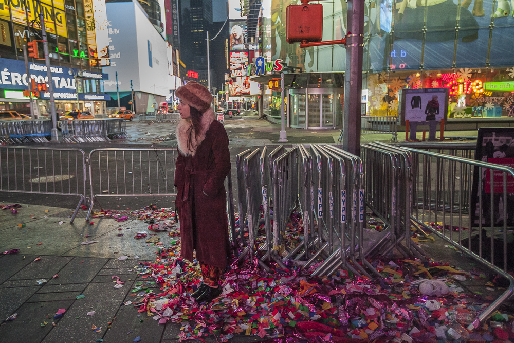 The remains of confetti from the New Years Eve ball drop just before sunrise in Time Square, New York City