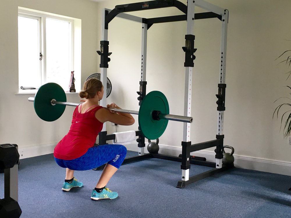 Front Squats  Click  HERE  for video