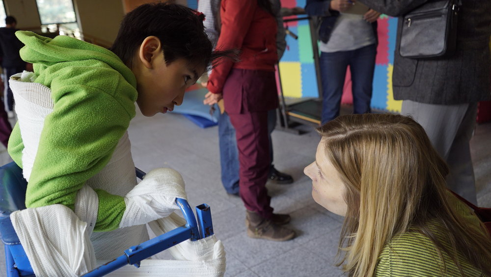Filming at an orphanage in Mexico where children with disabilities are restrained with bandages and duct tape