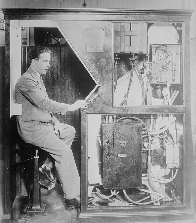 Photo-Booth inventor Anatol Josepho sitting in an original Photomaton which was made public in New York City in September, 1925.