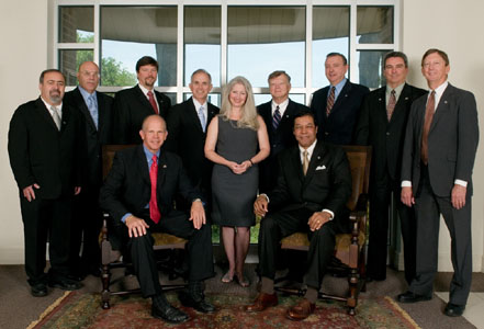 Pictured from back left: Ali Mustapha, Ted Thompson, Miles Williams, Richard Savoie, Norma Jean Mattei, Richard Danzy, Jim Bowie, Tim Allen, Ernie Gammon, Mark Jusselin, Rhaoul Guillaume