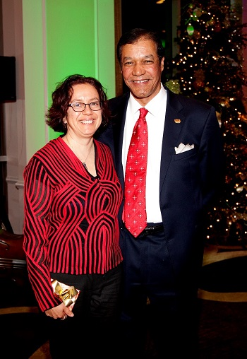 Rhaoul A. Guillaume, Sr. awards Ms. Fenix with a five year service pin during the 2013 Christmas party