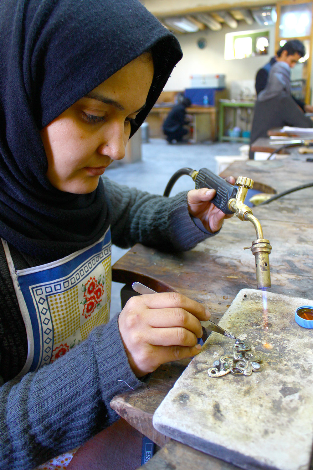 Artisan: Saeeda - After the fall of the Taliban, Saeeda was able to continue her education in Afghanistan. She enrolled at the Turquoise Mountain Institute, where she fell in love with the art of jewelry making.