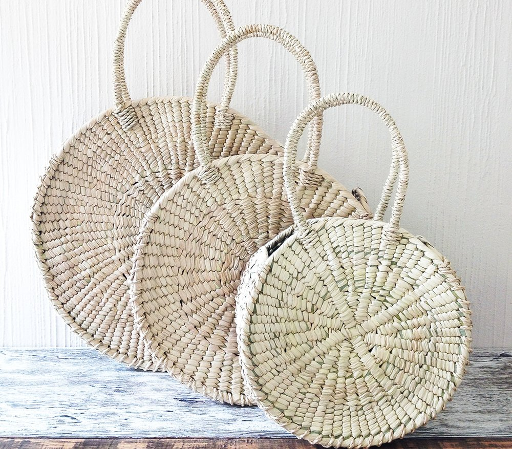 Our  CIRCULO Handwoven Palm Bags  from Mexico, a natural fan-favorite.