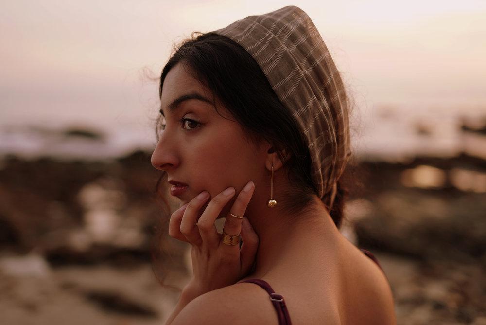 Aditi Mayer wearing the C heri Earrings .