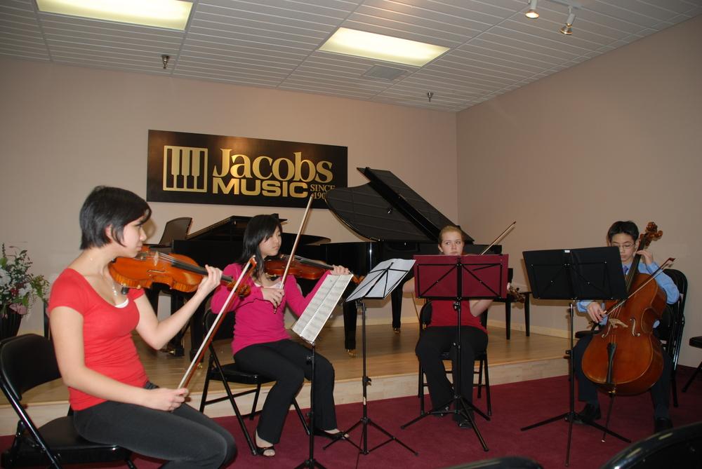 Quartet performing Handel's Hornpipe