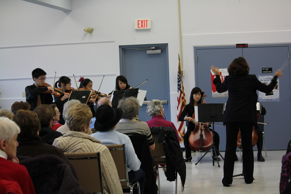 Mira Kang conducts the Bravura Youth ensemble