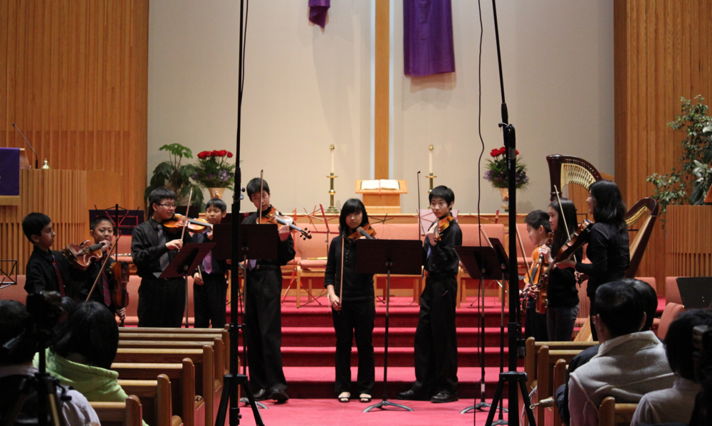 A youngviolin ensemble performs Telemann