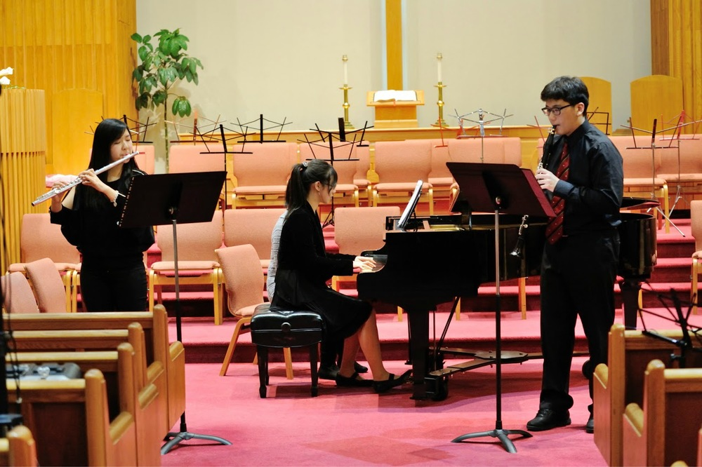 Wind and piano trioperforming Saint-Saens Tarentella