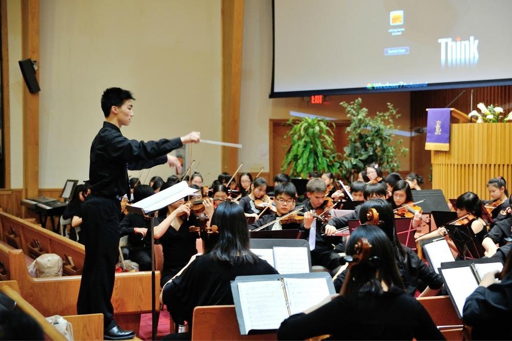 "Matthew Liu conducting ""The Cowherd and the Silk Weaver"""
