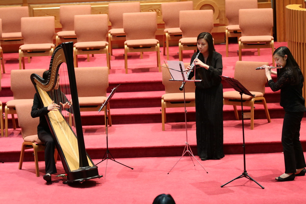 A lovely harp, oboe, and flute trio