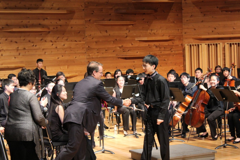 Rutgers Extension Divisi  on division director, Christopher Kenniff presenting award to cellist Patrick Kim