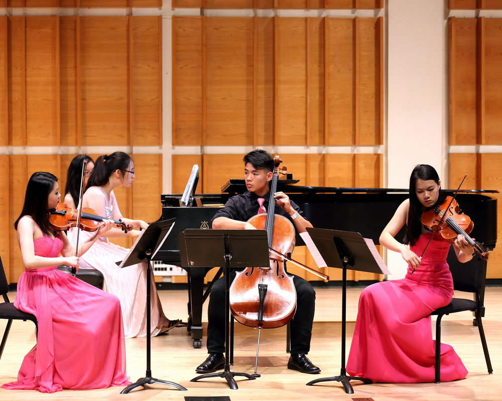 Katie Liu (violin), Iris Kwak (piano), Ethan Liaw (cello), and Jennifer Mao (viola) perform a Dvorak Quartet