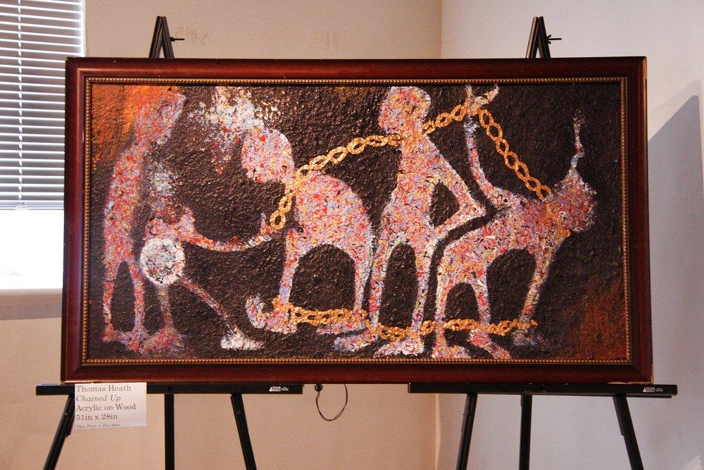 Heath Exhibit chained up.jpg