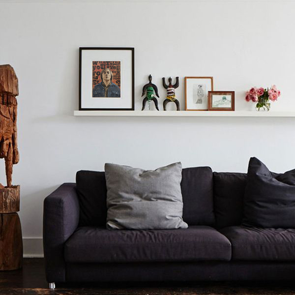 You don't always need to put a hole in the wall to display your newest art find. Most prints are perfectly staged on shelves leaning up against the wall alongside sculptures and other three dimensional items.