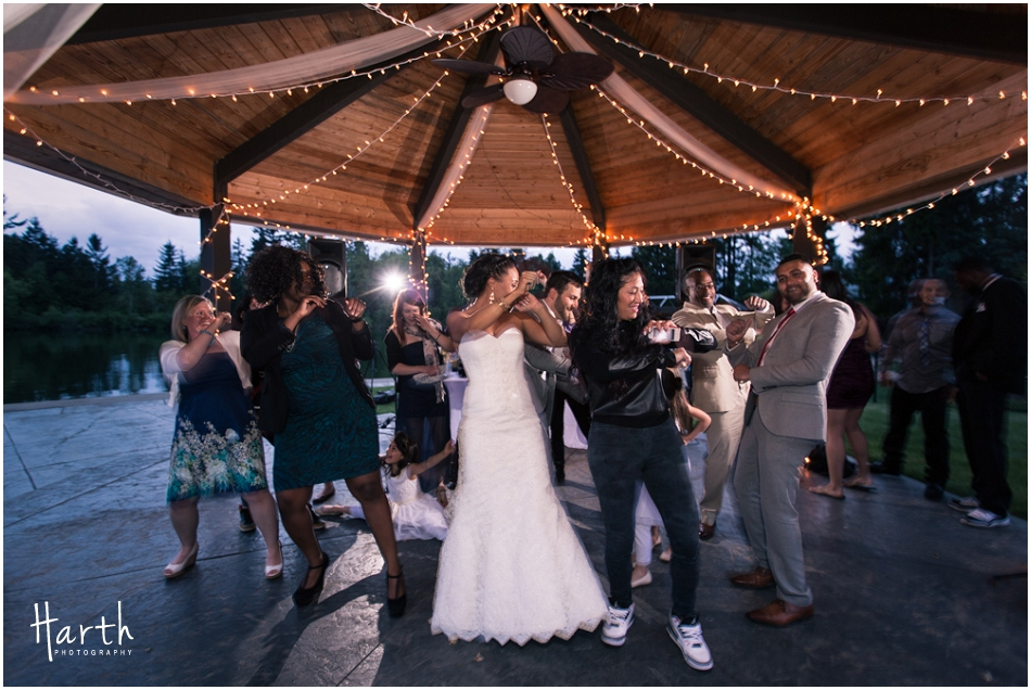 Bride dancing at the reception - Harth Photography