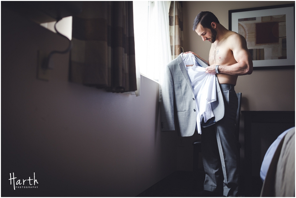 Groom checking out his wedding attire - Harth Photography