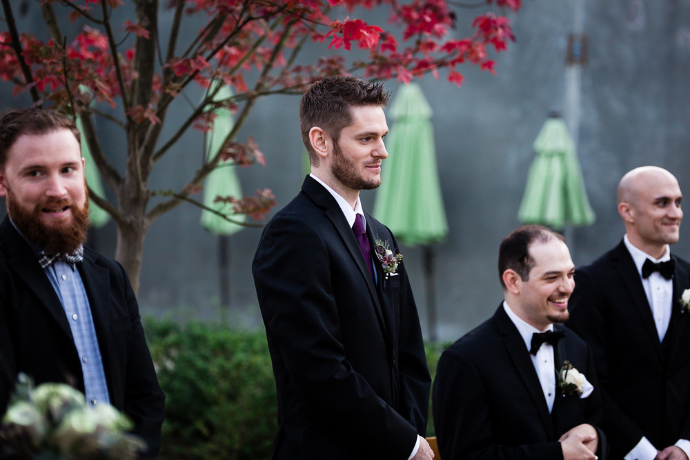 Groom sees bride coming down aisle