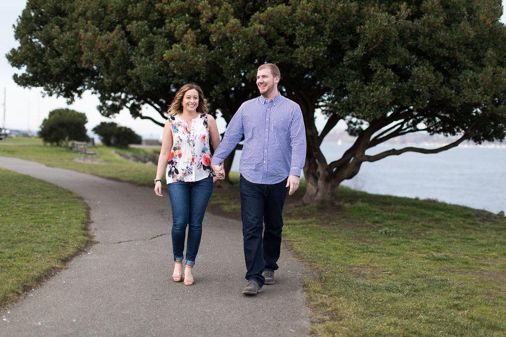 Couple walking along Alki Beach