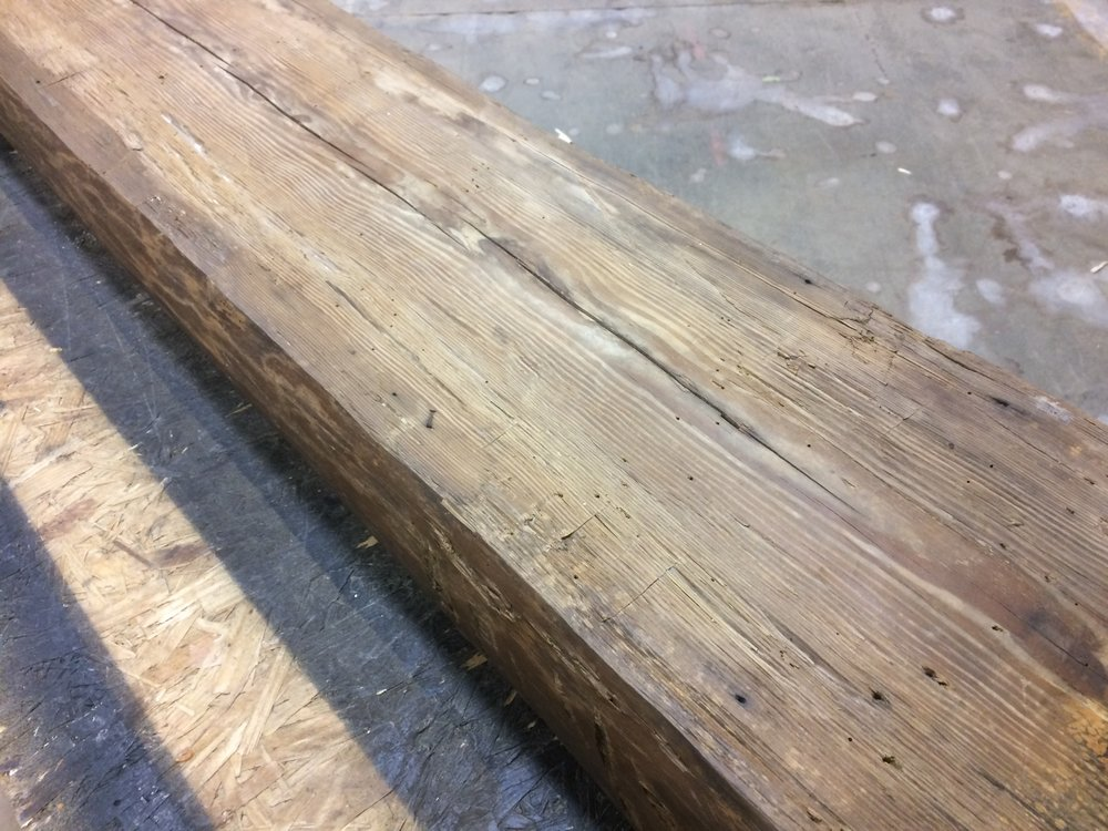 """Handhewn Beam Mantles: Available in lengths from 5' to 15', 5.5"""" thick and from 14"""" to 24"""" wide. Old growth heart pine from an c. 1830s log cabin from Cobb County Ga."""