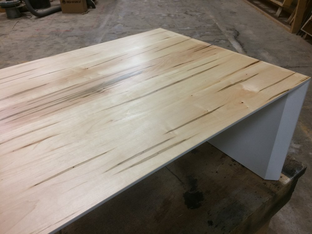 """Ambrosia Maple Coffee Table 46"""" x 29"""" x 18"""" Ambrosia maple with a satin clear coat and beveled edge. Edge and Undercoated in white lacquer. ITEM: CT AMECUC"""