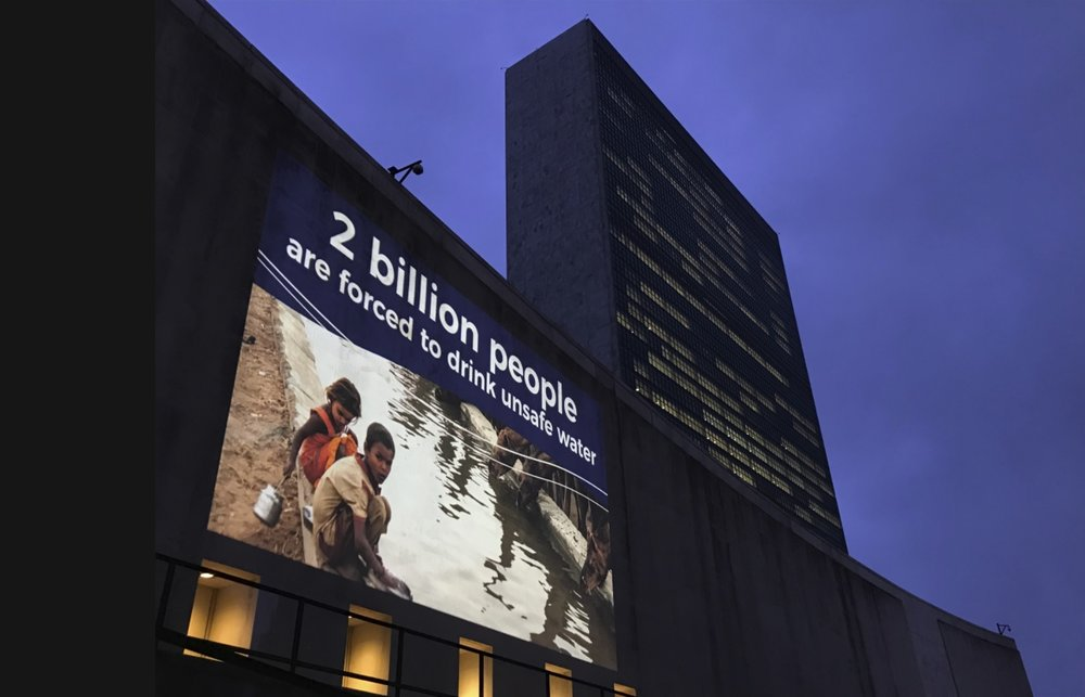 """The twelve winning photographs are being displayed at the United Nations for six weeks, and some photographs were projected onto the UN building itself."""