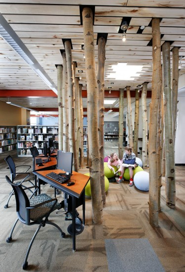 Our Associated Architect, OZ Architecture, came up with this circle of aspens as a way to identify the children's library and to provide some separation between the younger and older users of this space.