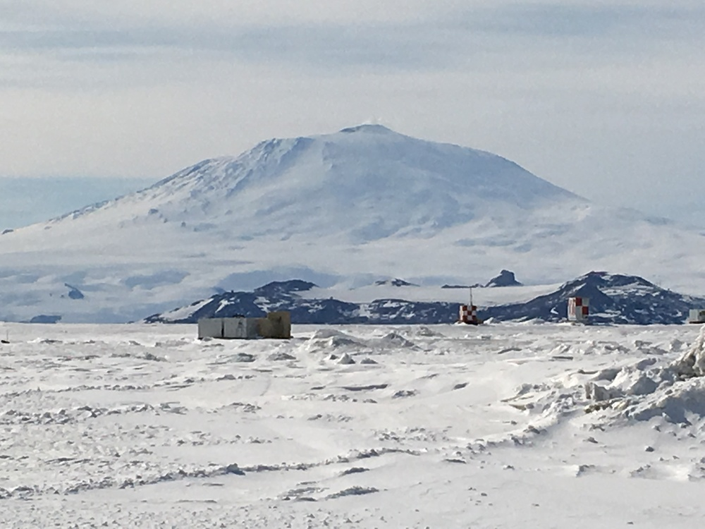 View of Mt. Erebus, the world's southernmost active volcano, with Pegasus Field (one of the two McMurdo airstrips) in the foreground.