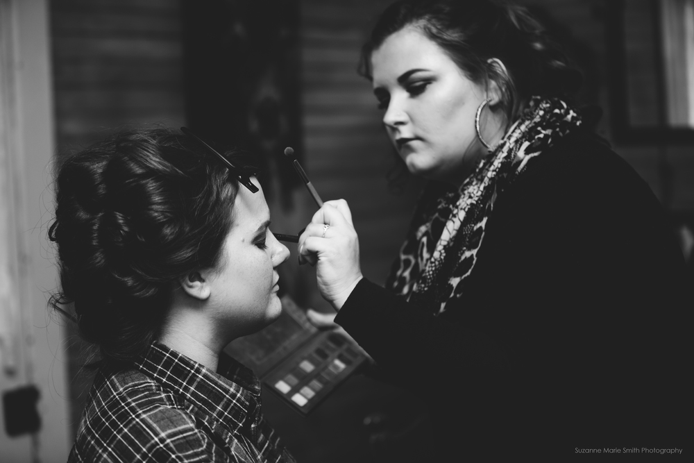 Getting her makeup done